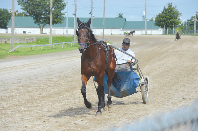 John Bombatch | Greene County News Drivers and trainers have had their horses out on the Greene County Fairgrounds' Chip Noble Racetrack for several weeks in anticipation of the upcoming harness races in August.