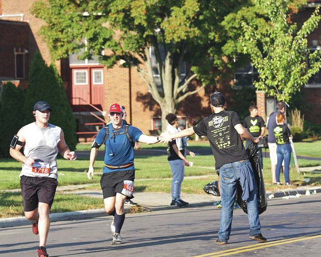 Barb Slone | Fairborn Herald Air Force Marathon runners had the opportunity to pass through downtown Fairborn during the race Sept. 16. Organizers offered attendees the opportunity to grab a bite to eat, design a sign, enjoy live music and cheer on the runners.