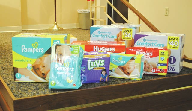 Whitney Vickers | Fairborn Daily Herald City council and staff purchased diapers in the spirit of Diaper Need Awareness Week, which were donated to Hannah's Treasure Chest.