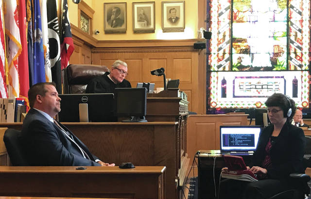 Bureau of Criminal Investigation (BCI) special agent Seth Hagaman (left) takes the stand during the Bret Merrick hearing. Also pictured is Judge Stephen Wolaver and court reporter Julie Hohenstein.