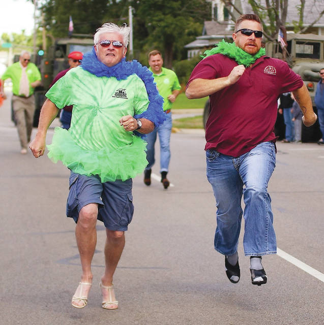 File photo Fairborn Council Member Terry Burkert in a tight race against Fairborn Senior Center Activities Coordinator John Errett in a previous Heels for Heroes event.