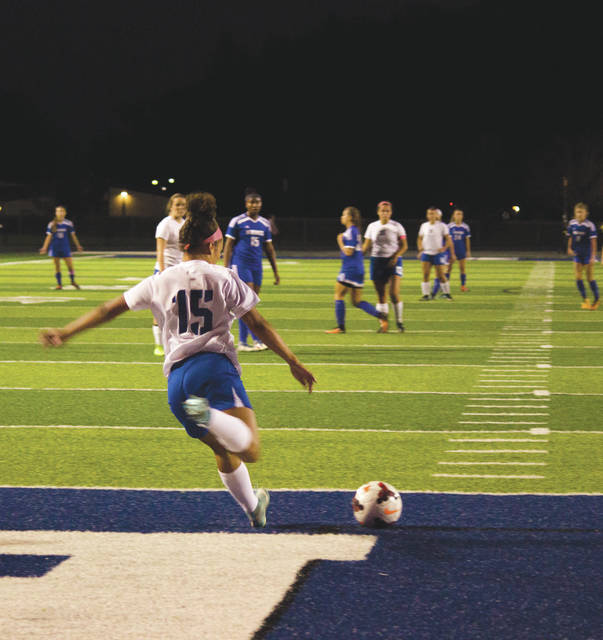 Sophomore defender Maliah Huston (15) gets off a Xenia goal kick during Thursday's Oct. 19 first-round Division I girls high school soccer sectional tournament match against Miamisburg, at Doug Adams Stadium in Xenia.