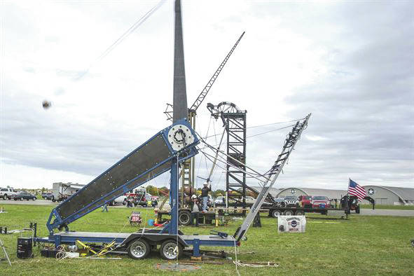 Submitted photo Team ETHOS' The Phoenix machine (foreground) launches a 10-pound pumpkin downrange at the 12th Annual Pumpkin Chuck, Oct. 21, 2016 behind the National Museum of the United States Air Force at Wright-Patterson Air Force Base.
