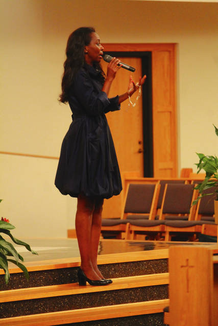 Anna Bolton | Greene County News Rosary in hand, Immaculée Ilibagiza shares her story with retreat-goers at St. Luke Catholic Church in Beavercreek Oct. 13-14.