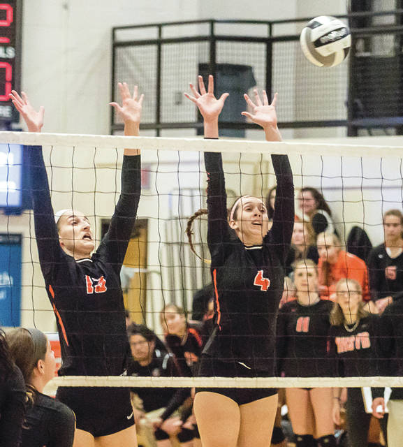 Sarah Laughman (13) and Kelly Goenaga-Lask (4) go up for a block attempt from the first time Beavercreek faced Centerville earlier this season. In the Oct. 12 match, Laughman led the Beavers with 13 kills and Goenaga-Lask topped the team in assists with 16.