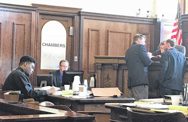 File photo Defendant Jevon Russell (left) takes notes during the August jury trial as assistant prosecutor David Hayes and defense attorney Charles Morrison approach Judge Michael Buckwalter.