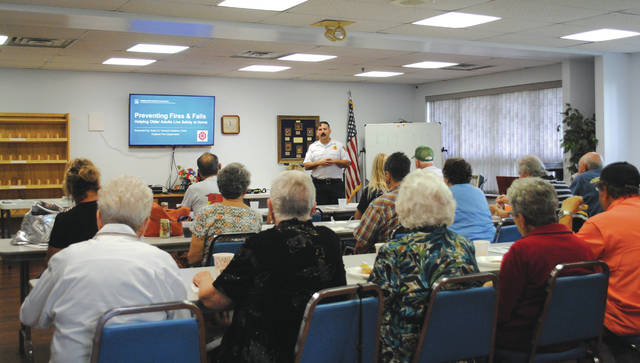 Whitney Vickers | Fairborn Herald Fairborn Fire Department Battalion Chief Adam Howard hosted a presentation that highlighted preventing fires and falls Oct. 11 at the Fairborn Senior Center as part of its Lunch and Learn program.