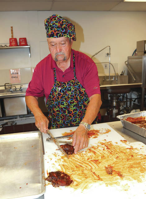 Barb Slone   Fairborn Herald The Fairborn Senior Center hosted its annual rib fest Oct. 14. Leroy Farthing gave smiles to attendees with his homemade baby back rib recipe.