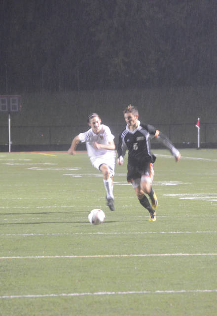 Senior captain Dominic Calabrese (5) drives away from a Centerville defender on a cold and rainy Nov. 1 night at Jim VanDeGrift Stadium in Lebanon. Calabrese scored two goals in Beavercreek's 4-1 Division I regional semifinal win.