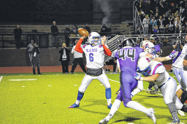 Greeneview junior quarterback Nick Clevenger (6) fires a first-half pass in Friday's Nov. 3 high school football playoff game at Cincinnati Hills Christian Academy. Host CHCA won the Division V first-round game, 47-24.
