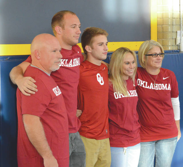 The Hoskins family (left to right), dad Tom, brother Andrew, Tommy, sister Corissa and mom Tracy, were decked out in their Oklahoma Sooners T-shirts in support of Tommy's National Letter of Intent signing, Nov. 17, in the Barnett Building wrestling room on the Legacy Christian Academy campus in Xenia.