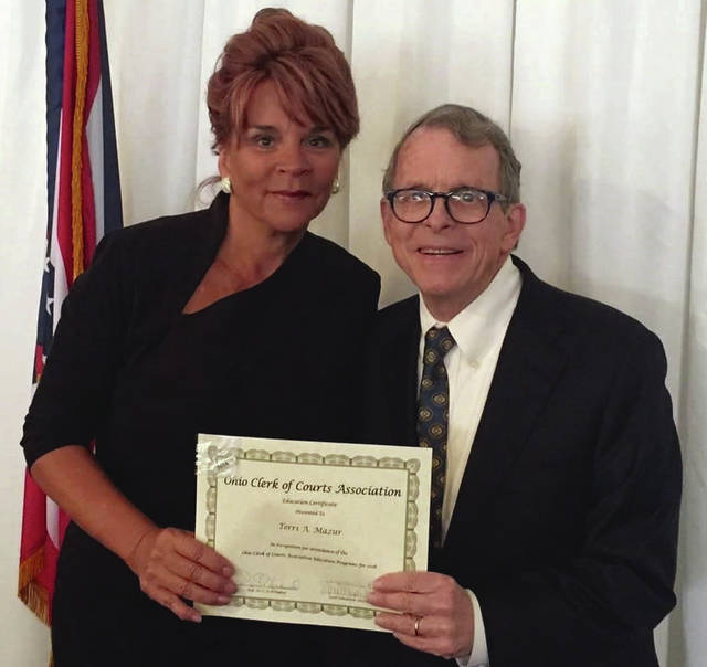 Submitted photo Greene County Clerk of Courts Terri Mazur was presented the Ohio Clerk of Courts Association Education Certificate by Ohio Attorney General Mike DeWine earlier this year. It was the 20th annual education certification Mazur earned since taking office in 1997. She is retiring at the end of the year.