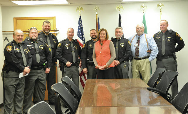 Submitted photo Greene County Sheriff Gene Fischer, Sgt. Sean Magoteaux, Dep. Chris Moore, Dep. Howard Wooten, Dep. Sherman Thatcher, Maj. Rick Bowman, Capt. David Tidd and Sgt. Shawn Prall recently presented an office donation to Michael's House Executive Director Teresa Wiles.