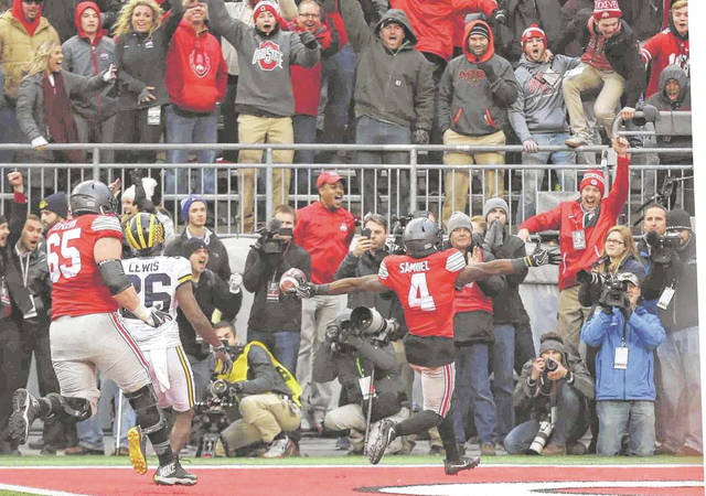 Curtis Samuel (4) scores the winning touchdown in Ohio State's 30-27 double overtime win over Michigan last year in Ohio Stadium.