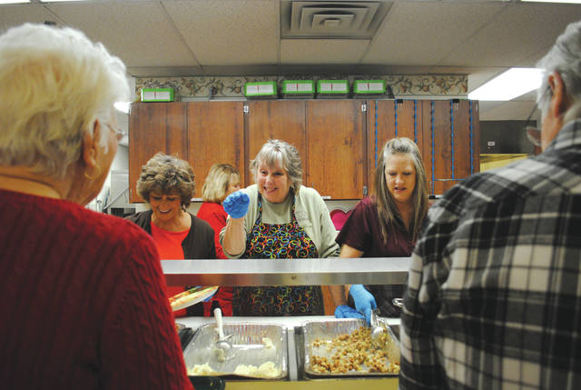 Whitney Vickers | Fairborn Herald Ellen Slone-Farthing, executive director of the Fairborn Senior Center (center), serving up turkey and complimentary meal items to members Nov. 16 during its members Thanksgiving event.