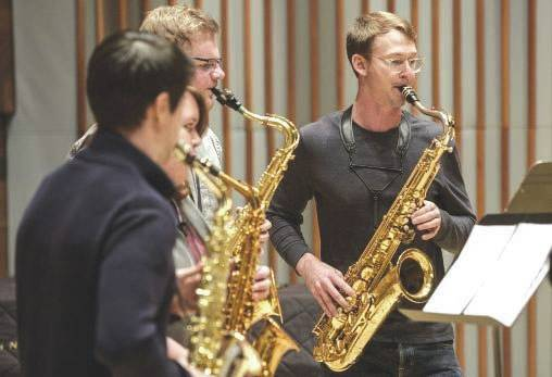 Submitted photo Michael Sawzin, a 2009 Wright State graduate, playing with Wright State saxophone students during his quartet's master class in Schuster Hall.