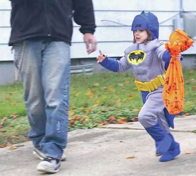 Barb Slone | Fairborn Herald Superheroes, princesses, monsters, pirates and more took to the the streets of Fairborn Oct. 31 to collect treats and maybe pull a few tricks, too.