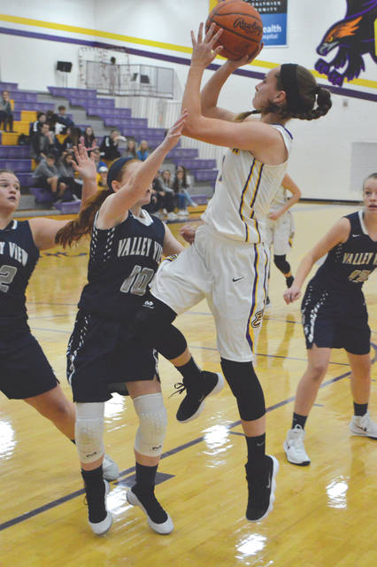 Cassidy Hofacker puts up a shot over a pair of Valley View defenders, Saturday, Dec. 2 at Bellbrook High School.