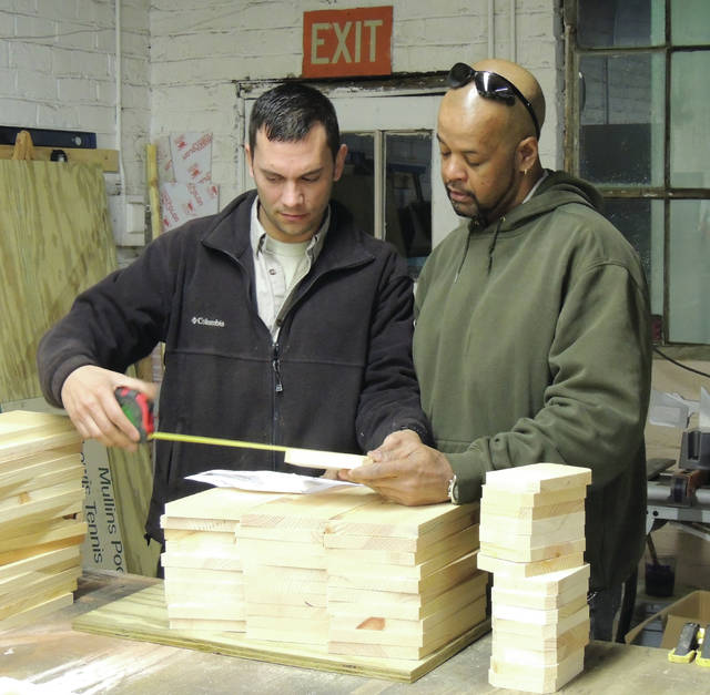 Submitted photo GCP&T Maintenance Lead Grant Burtch and Maintenance Supervisor Dave Dudgeon work on assembling bluebird box house kits.