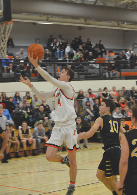 Beavercreek sophomore Brayden Walther (4) lays in a score in the first half of a boys high school basketball game against visiting Centerville. Walther scored a team-high 11 points in the Dec. 19 loss to the Elks.