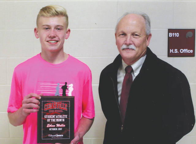 Ethan Wallis (left, with Mike Reed) was chosen as the Edward Jones Investments Athlete of the Month for October for Cedarville High School. This award is being sponsored by the office of Mike Reed at Edward Jones Investments of Xenia, serving Xenia, Jamestown, Cedarville and surrounding areas. Wallis, a freshman on the cross country team, was second in the Ohio Heritage Conference, sixth at the district cross country meet, sixth in the regional and 24th in state, and was named the division's all-state top freshman. He is a talented athlete with a positive attitude and grade-point average over 3.5.