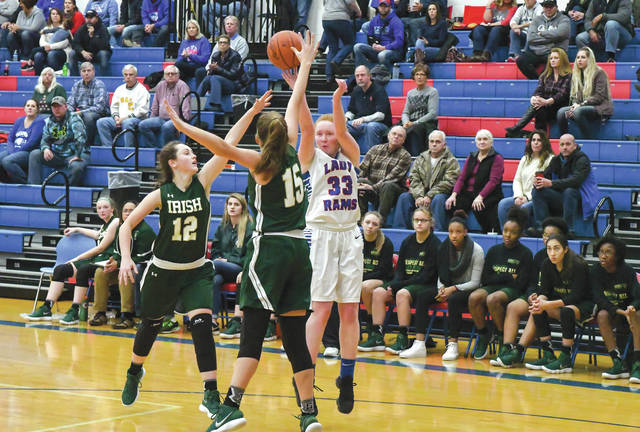 Senior Faith Strickle (33) shoots a 3-point shot over a pair of Springfield Catholic Central defenders in Saturday's Dec. 9 win at Greeneview High School. Strickle said she's worked on her outside shooting game during the off-season.