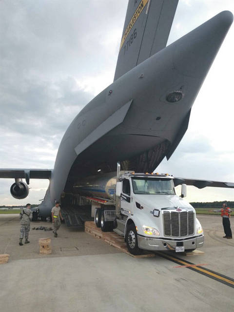 Submitted photo A fuel tank truck is loaded onto a C-17 aircraft, for delivery to Puerto Rico, to assist in the hurricane recovery efforts. The Air Force Life Cycle Management Center's Air Transportability Test Loading Activity office at Wright-Patterson Air Force Base, ensured the aircraft was able to carry the fuel truck and that it was properly secured.