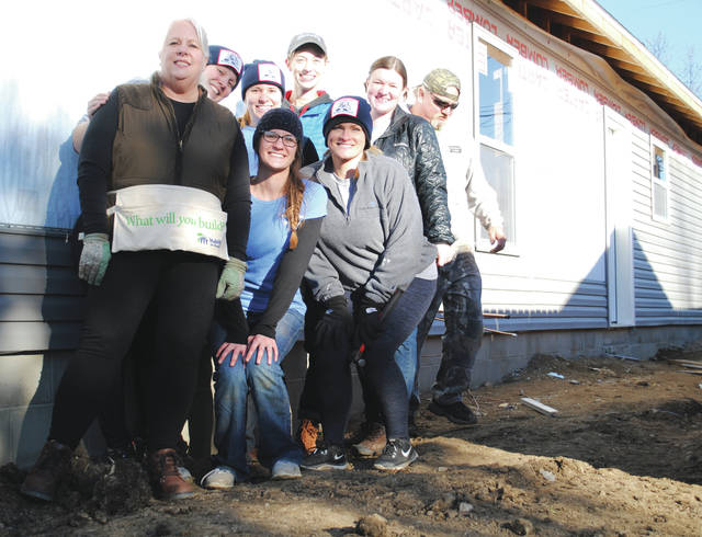 Employees of Flagel Huber Flagel, a Dayton/Cincinnati accounting firm, were completing some work on the home Dec. 20. Employees of the business take part in various other volunteer projects throughout the year.