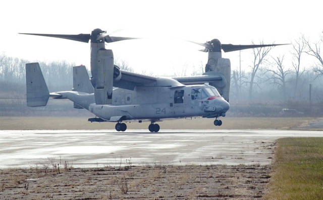 Submitted photo An U.S. Marine Corps MV-22 Osprey belonging to Air Test and Evaluation Squadron 21 (HX-21) lands at Wright-Patterson Air Force Base, Area B, near the National Museum of the Air Force Dec. 19. The aircraft was signed over to Naval Medical Research Unit-Dayton to be used in research to minimize injuries to aircrew members.