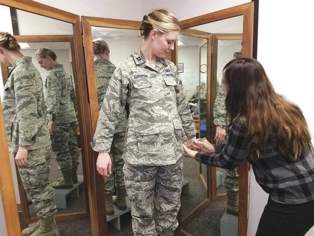 Submitted photo Stacey Butler (right) a clothing designer with the Air Force Life Cycle Management Center's Air Force Uniform Office, measures Capt. Taylor Harrison's maternity airman battle uniform. The new uniforms were designed and developed by the office and are available to pregnant airmen around the world.
