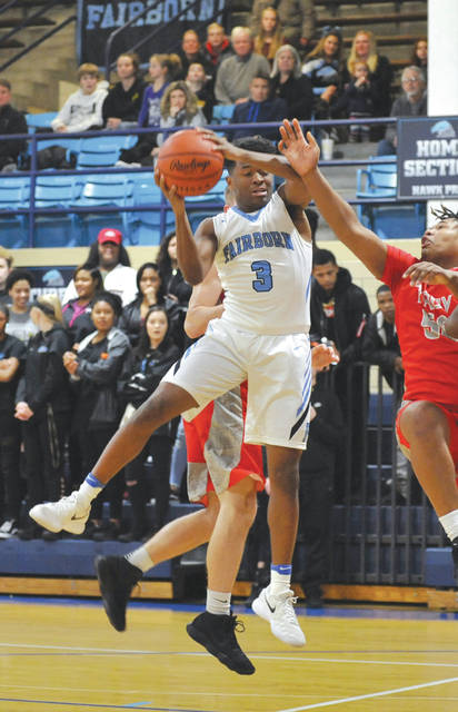 Fairborn's Shaunn Monroe pulls down a rebound, during a Jan. 9 home game against Troy. Monroe scored a game-high 25 points in the 58-35 win in the Baker Middle School gymnasium.