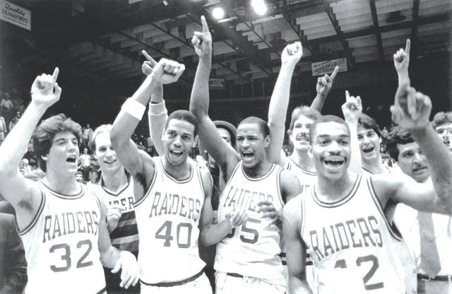 Wright State University basketball players, front left to right, Rob Sanders, Fred Moore, Steve Purcell and Anthony Bias celebrate after winning the 1983 NCAA men's Division II national basketball championship.