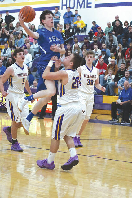 Jay Evans of Xenia puts up a shot over Bellbrook's Donnie Crouch, during a Jan. 26 boys high school basketball game in Bellbrook. Evans was one of three Buccaneers players to score in double figures. Crouch led all scorers with 34 points.