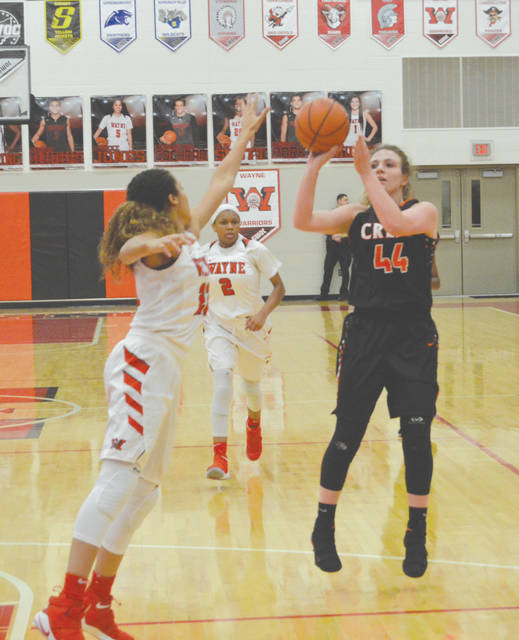 Beavercreek senior forward Lexi Moore (44) puts up a shot in the first half of Wednesday's Jan. 31 girls high school basketball game against Wayne in Huber Heights.