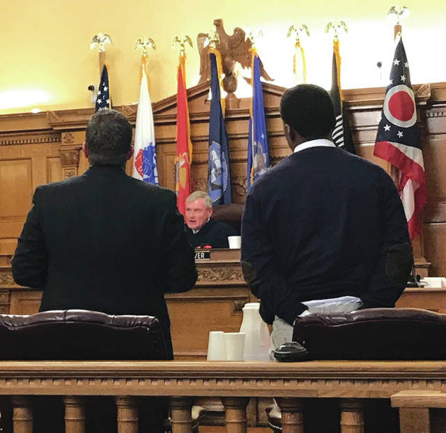 Anna Bolton | Fairborn Herald Defense Attorney Travis Kane and defendant Myron Walker listen to Judge Stephen Wolaver during trial Jan. 23.
