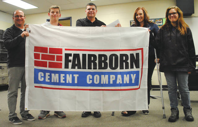 Whitney Vickers | Fairborn Herald Fairborn Cement Company donated $5,000 to the Fairborn Music Club to help fund the costs of new uniforms. With the donation, music club officials said production for the new uniforms is expected to begin in March which has taken the club three years of fundraising and accepting donations to accomplish.