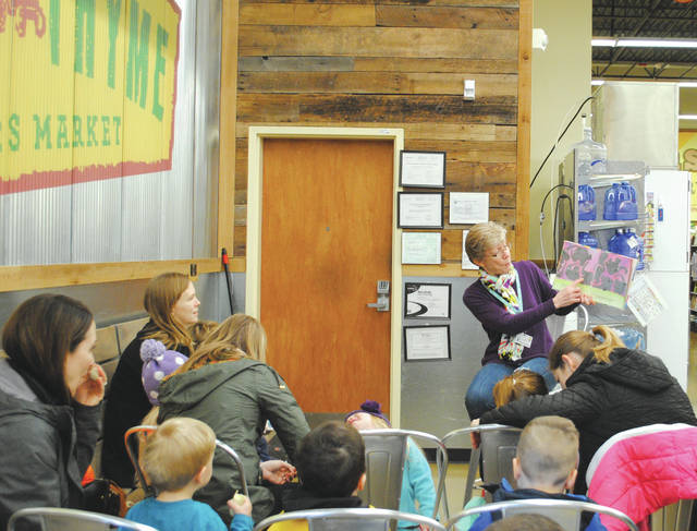 Whitney Vickers | Greene County News The Greene County Libraries hosted story time at Fresh Tyme Jan. 31 in the Beavercreek store. There, children and parents enjoyed stories highlighting elephants — complete with an song and dance that highlighted elephants.