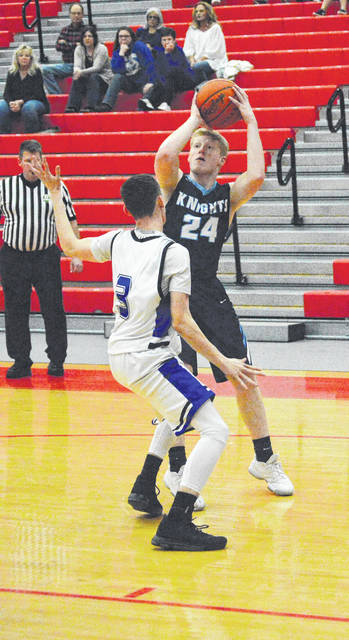 Legacy Christian Academy senior guard Ashton Burke (24) scored the 1,000th point of his high school career on this shot, on the opening score of Wednesday's Feb. 28 boys sectional tournament basketball game at Troy High School. Burke scored LCA's first 13 points, finishing with a game-high 17, in the Knights' 64-25 win over Yellow Springs.