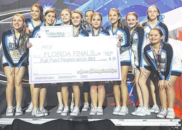 Submitted photos Baker Middle School's competition cheerleading team received a free entry in to a national competition in Florida.