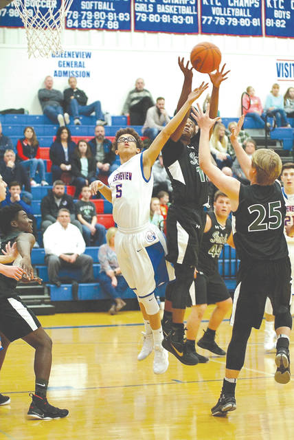 Greeneview senior forward Cam Treadway (5) battles Springfield Catholic Central's Sabien Doolittle (10) and Jacob Woeber (25) for a rebound, during the first half of Friday's Feb. 2 boys high school basketball game at Greeneview High School in Jamestown.