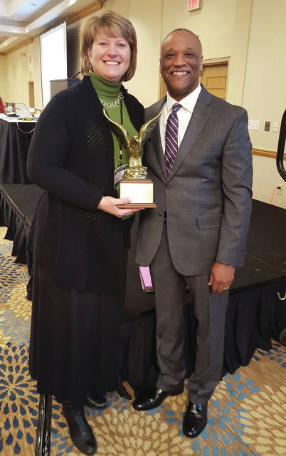 Submitted photo Fairborn Municipal Court Judge Beth W. Cappelli recently received the 2018 President's Award, presented by Dayton Municipal Court Judge Carl Henderson, at the Association of Municipal/County Judges of Ohio Winter Conference.