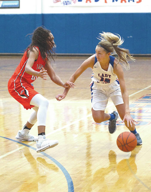 Greeneview's Frankie Fife (right) drives against Cedarville's Celeste Rucker, during a Feb. 10 girls high school basketball game in Jamestown. Fife became the third Greeneview player to surpass the 1,000 career point mark in Saturday's win.