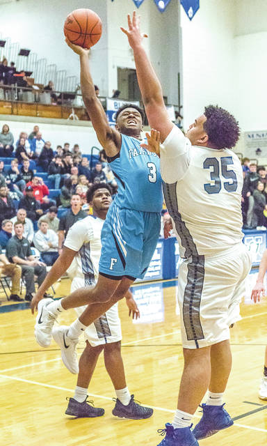 Fairborn junior guard Shaunn Monroe (3) puts up a shot against Xenia's Norde' Uloho (35) in Saturday's Feb. 3 boys high school basketball game in Xenia. Monroe scored a game-high 28 points to lead the Skyhawks to a 61-43 win.