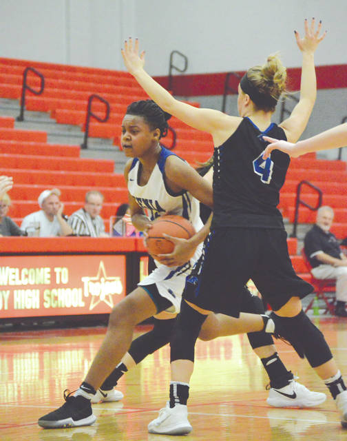 Trinity Morton-Nooks, Xenia's leading scorer during the regular season, was double teamed throughout Wednesday's Feb. 21 girls high school basketball game at Troy High School. Springboro defeated Xenia, 61-14 to advance in the Division I sectional tournament.