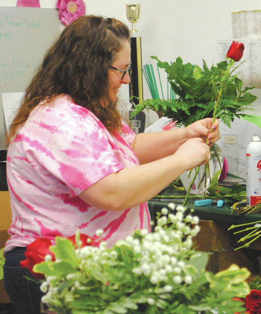 """Florists and Hollon Flowers officials include Carolyn Hollon (owner), Yo Schiely, Jocelyn Whitt, Kristin Pitstick and Jamie Brauer. Officials joked that Hollow Flowers has been """"saving marriages and relationships"""" since 1990."""