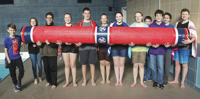 Submitted photo Members of the Catholic Chapel Youth Group gave the sport of log rolling a try at the Dodge Gym pool at Wright-Patterson Air Force Base. Log rolling is growing in popularity across the U.S. especially in youth and collegiate aquatic programs.