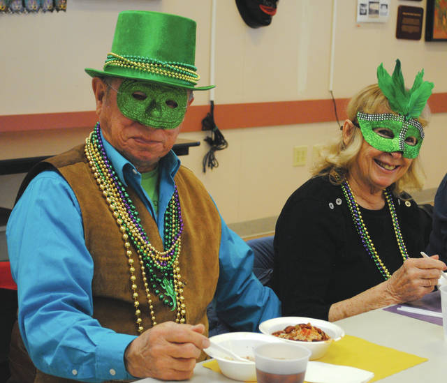 "Whitney Vickers | Greene County News Fairborn Senior Center members were ""raising their glasses"" Feb. 12 in celebration of Mardi Gras. Face masks, beads, live music and food topped off the celebration."