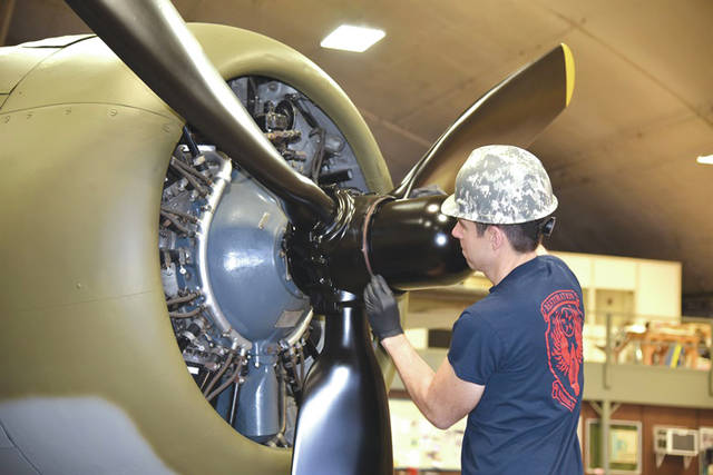 Submitted photo National Museum of the U.S. Air Force Restoration Specialist Casey Simmons installing propeller number one on the Boeing B-17F Memphis Belle. Plans call for the aircraft to be placed on permanent public display in the WWII Gallery here at the National Museum of the U.S. Air Force on May 17, 2018.