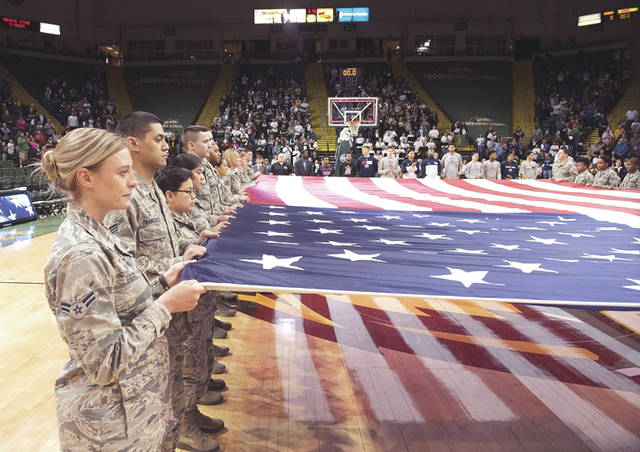 Submitted photo Airmen from Wright-Patterson Air Force Base hold a large American flag during a pregame ceremony prior to a Wright State University basketball game Jan. 26.