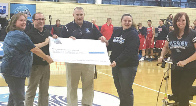 Submitted photo the Skyhawk Athletic Club made a donation of $2,210 to the Fairborn Music Club to help purchase new band uniforms. They hosted a check presentation at the Fairborn High School boy's varsity basketball game vs. Piqua.